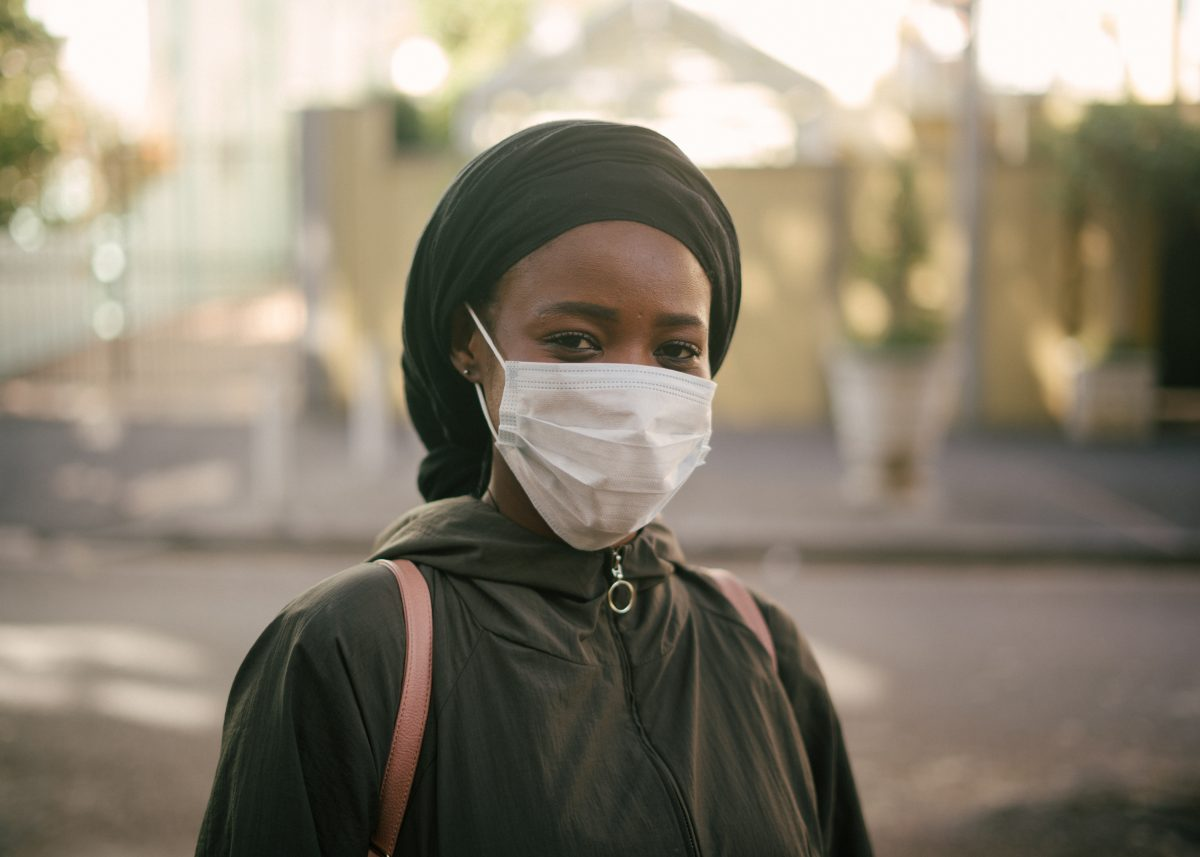 african-american-woman-in-face-mask-on-city-street-4177882